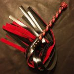 red and black monster flogger